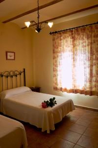 Dormitorio de la casa rural en Yeste - Casas Rurales Amable